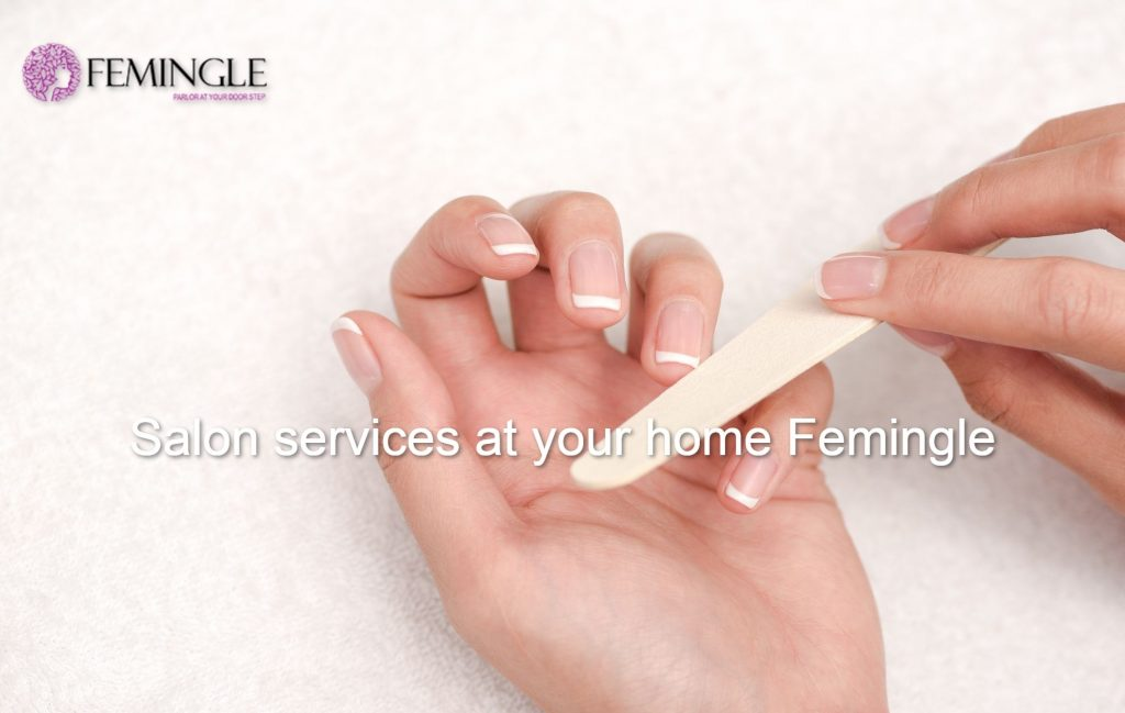 woman-hands-in-a-nail-salon-receiving-a-manicure
